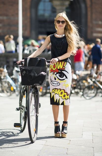 Street style - black singlet top; bold print skirt; black handbag & vintage bicycle