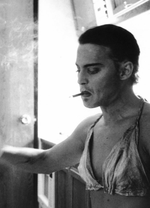 """Actor Johnny Depp dressed in drag on the set of the 2000 Julian Schnabel film """"Before Night Falls"""" also starring Javier Bardem."""