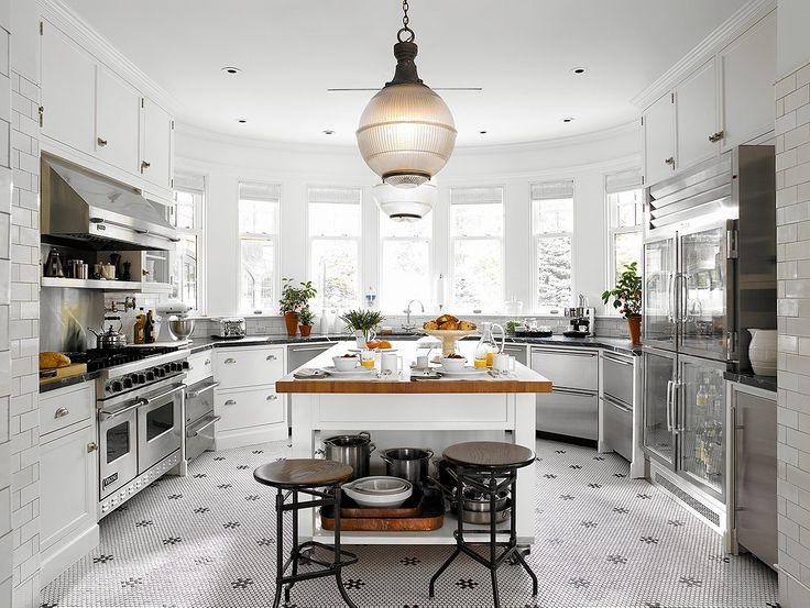 I love that they use these floors in this kitchen!
