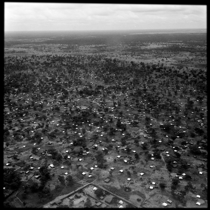 An aerial views of the Yida camps, where some 60,000 Sudanese refugees are seeking sanctuary just 12 miles inside the borders of South Sudan, and where mortality rates for children and adults alike are well above emergency thresholds.  South Sudan 2012 © John Stanmyer/VII