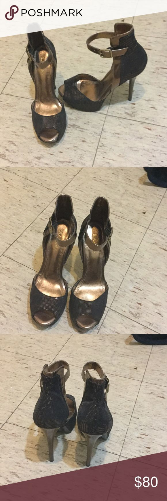 High heeled bronze shoes Metallic bronze and black shoes. Heel height is 3in high. Very comfortable great party or date night heels. Great color to add to your collection of shoes. Bakers Shoes Platforms
