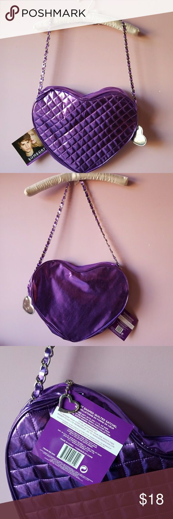 """Purple Shiny Heart Satchel Purse Justin Bieber New With Tags!  Shiny Purple Heart Lame Vinyl ! Quilted Pattern on Front  Satchel Purse Tote Justin Bieber  Zip Top Lined Bonus Silver Heart Key Chain Tag Purple Lame Accents Thru the Sturdy Silver Chain Link Strap Strap Drop 15"""" 3"""" Expansion  @ 15"""" Wide @ 12"""" Tall   ✔BUNDLE UP FOR SAVINGS ✔ Justin Bieber Bags Satchels"""