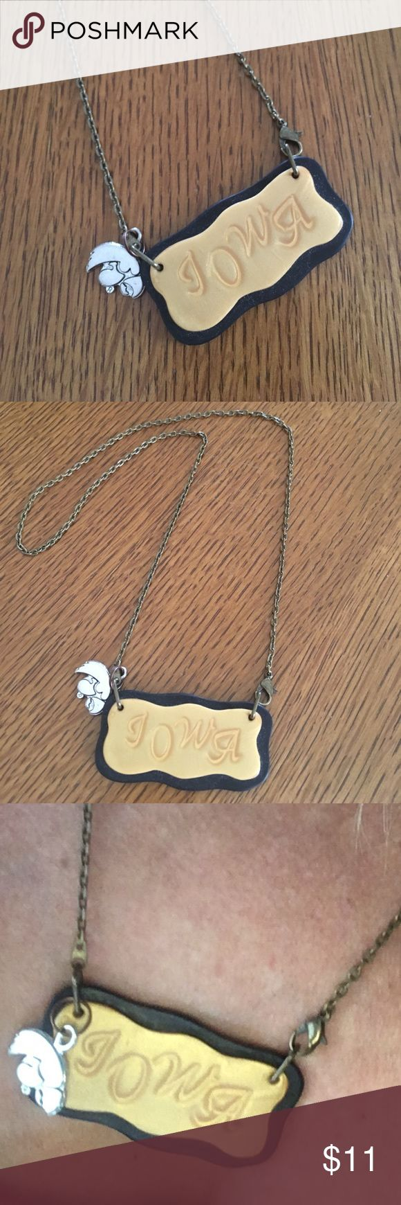 Unique handmade IOWA necklace. Very light weight Clasp opening down at bottom by Iowa pendant. Added tiger hawk charm. Go Iowa ! Football 🏈 is approaching fast Jewelry Necklaces