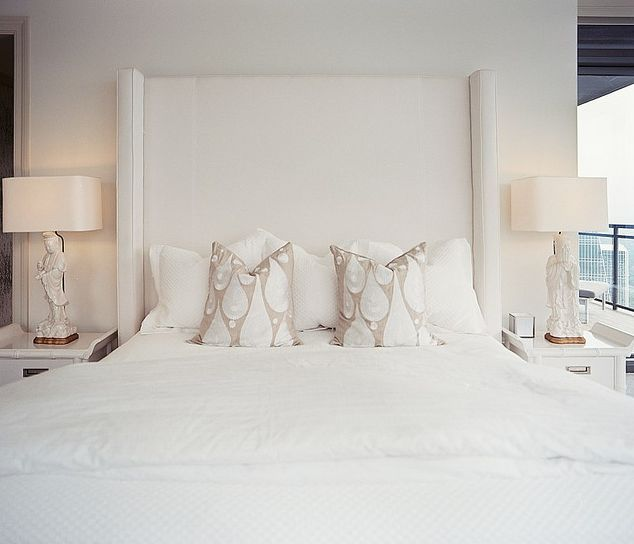 Monochromatic Bedroom With Tall White Upholstered
