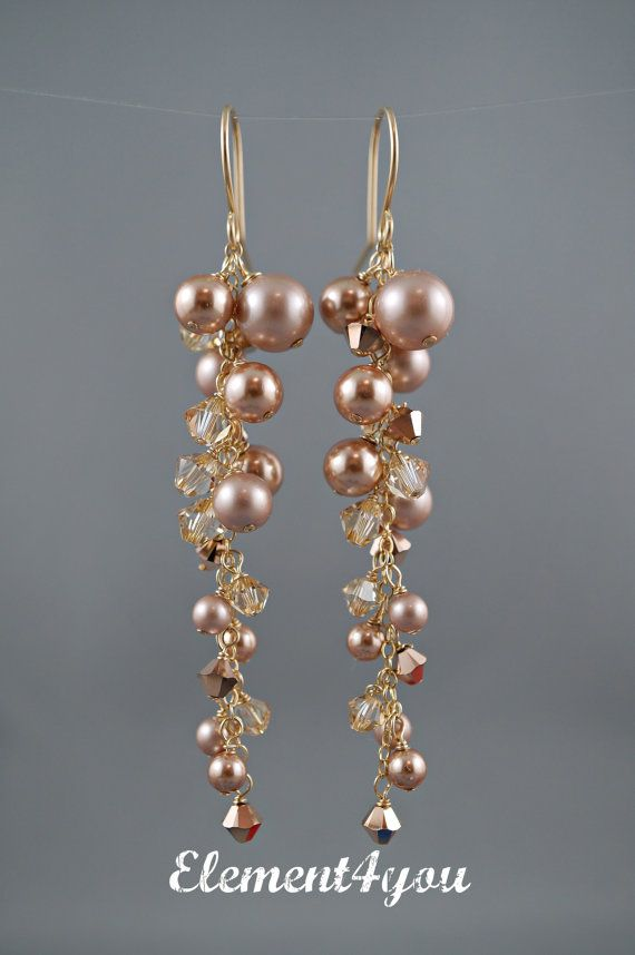 These elegant earrings are made with all Swarovski light champagne and rose gold pearls mix with Swarovski golden shadow and rose gold crystals in a cascading drop. Total length measures approximately 3 long including the ear wires.  All materials used are 14k gold filled materials.  Link to matching hair comb: https://www.etsy.com/ca/listing/467433114/fall-bridal-gold-comb  Thanks for stopping by.