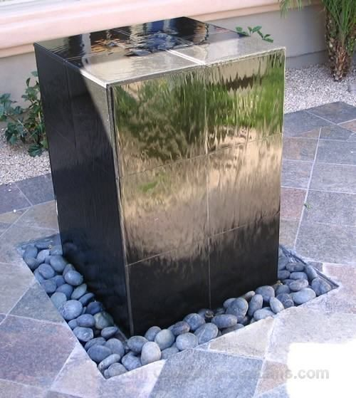 Contemporary Outdoor Fountain Design with Stone Accessories