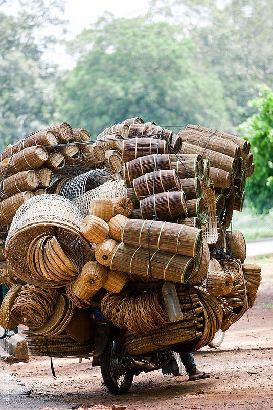 Craftsman with wicker objects on motorcycle in Siem Reap street. by BONNINSTUDIO | Stocksy United