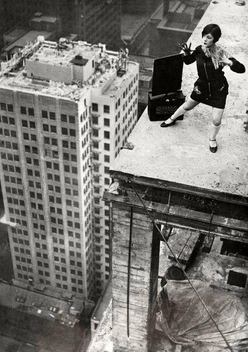 A dancer dances on top of a skyscraper, Charleston, USA, 1926 via Vintage Everyday
