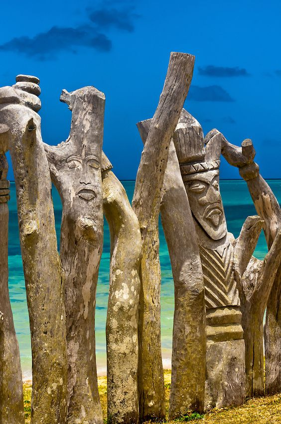 Carved totem poles, St. Maurice Bay, New Caledonia
