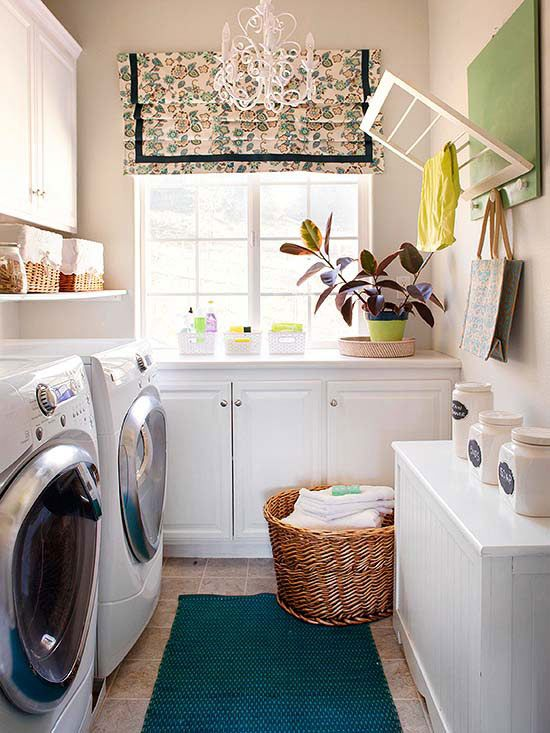The natural inclination in this sort of laundry room would be to place the appliances under the windows. But these homeowners gained much more storage and work space by shifting that by a half turn, placing a long work counter under the window with cabinets and a shelf above the washer-dryer combo. Think about narrow areas differently to gain more laundry options: A pull-down drying rack saves space by folding up when not in use./