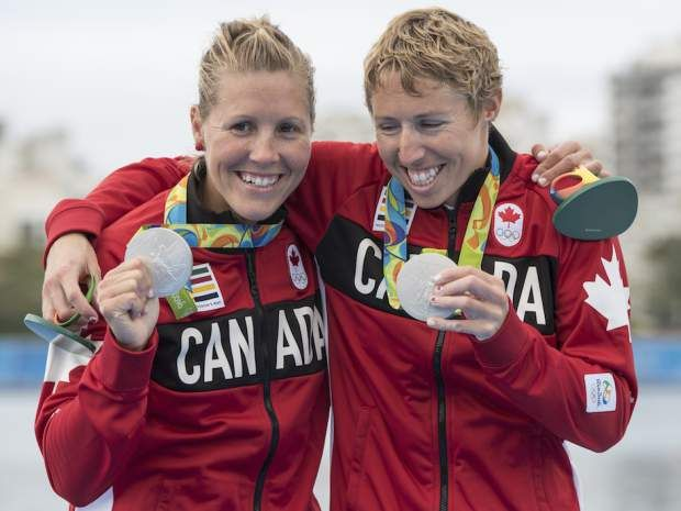 August 12, 2016 - Lindsay Jennerich (left) and Patricia Obee (right), of Canada, celebrate their silver medal win in women's lightweight double sculls in Rio 2016 Olympic Games in Rio de Janeiro, Brazil, , Friday, August 12, 2016.