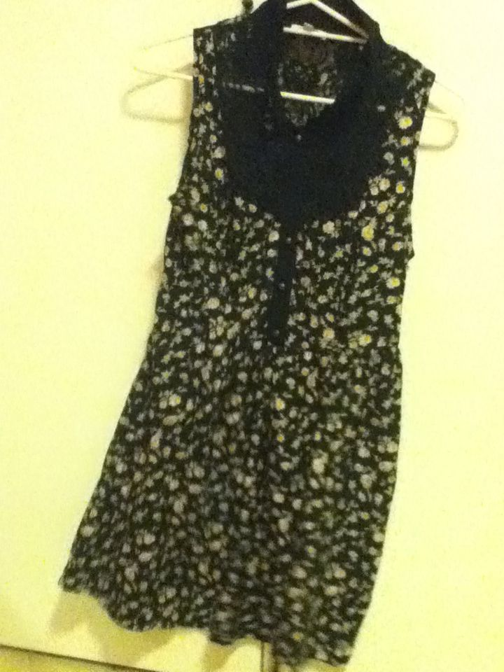 11 - dark floral dress, Peter Pan type collar, SES size 12. Size twelve is for the decent length and it also works well with baby boobies like mine