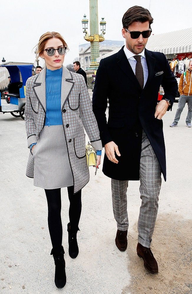 Olivia Palermo wears a structured plaid blazer and skirt with a bright blue blouse at Paris Fashion Week