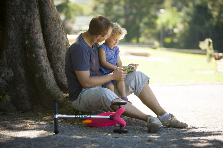 A father and son sharing family time together with their Mini Micro Scooter