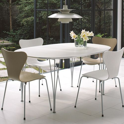 The Super Elliptical Fritz Hansen table has a white matt finish with a silver-tone stainless steel frame.