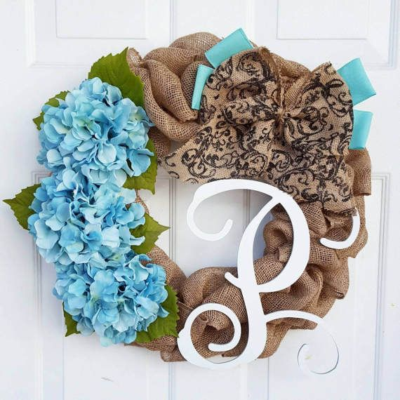 Sizes available:  18 inch: $74.95  21 inch: $84.95 (pictured)  This burlap wreath is dressed with 3 teal oversized hydrangeas accompanied with a double layered burlap bow. Included is a 12 hand-cut wood monogram, script font. Any color is available for the monogram, unless otherwise specified, I will paint it standard white.  **Please note this particular color of hydrangea is seasonal - similar colored flowers will be used in off-seasons**