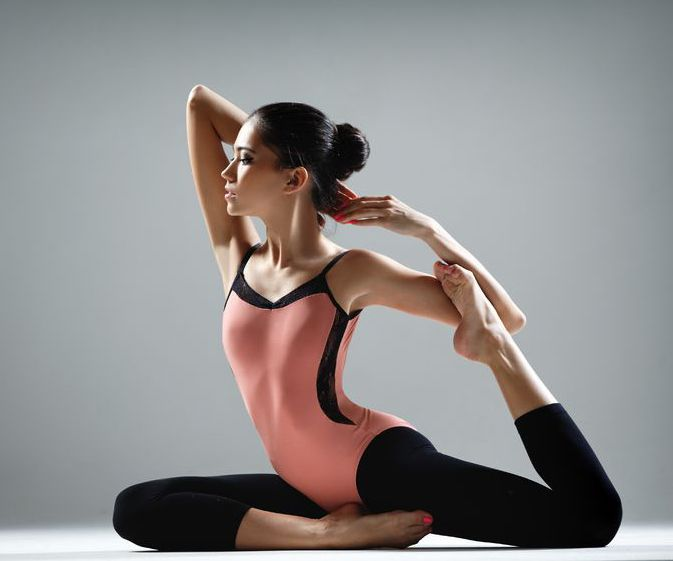 4 Yoga Stretches for Long, Lean, Dancer Legs
