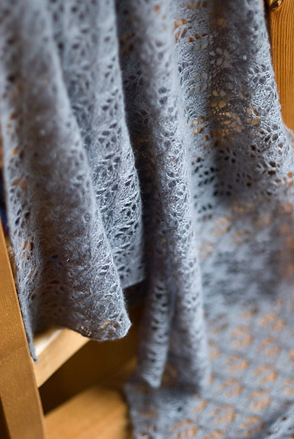 birch by sharon miller. i love this shawl and have knitted it twice, both in rowan kidsilk haze. once in black and once in jelly. fabulous!