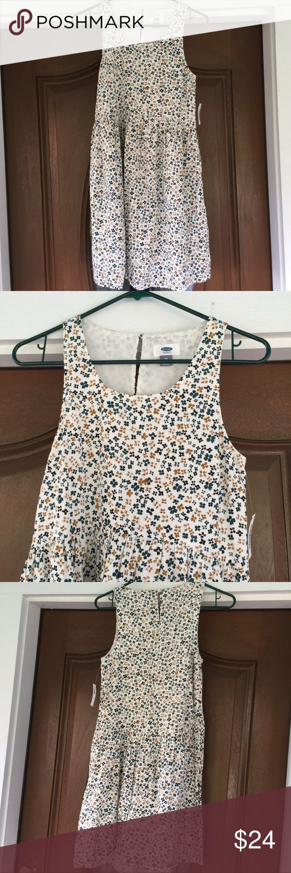 """NWT🚨OLD NAVY Floral Dress NWT🚨OLD NAVY Floral Dress.   Babydoll style.  Wear with leggings.  Sleeveless.  Keyhole in back neckline.   Fully lined.  Cream, blue & brown Floral patterned rayon material.   Pit-to-pit 16-1/2"""".  Waist 32"""".   Length 33"""" (shoulder to hem).  NWT Old Navy Dresses Mini"""