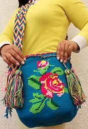 Genuine Wayuu Mochila, entirely handmade by Wayuu Indian Artisanas in La Guajira State, Colombia, South America. Our mochilas are woven from cotton yarn. Because this is a handmade product, dimensions vary slightly between individual bags. This mochila is approximately 11 inches deep, and its circular bottom has a diameter of approximately 9 inches.