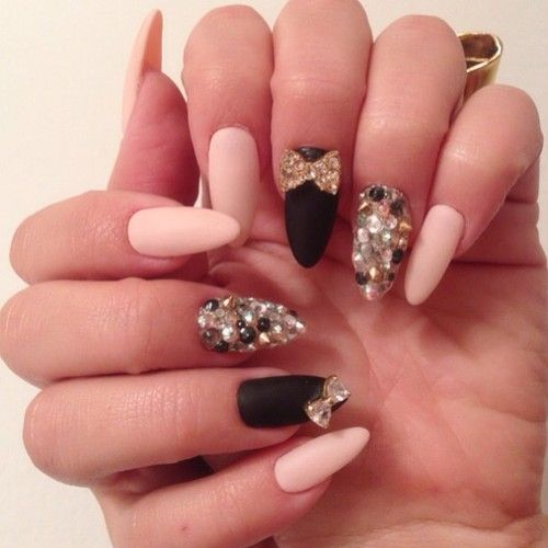 Not a fan of almond or pointed nails; but I like the pink and black, with bows
