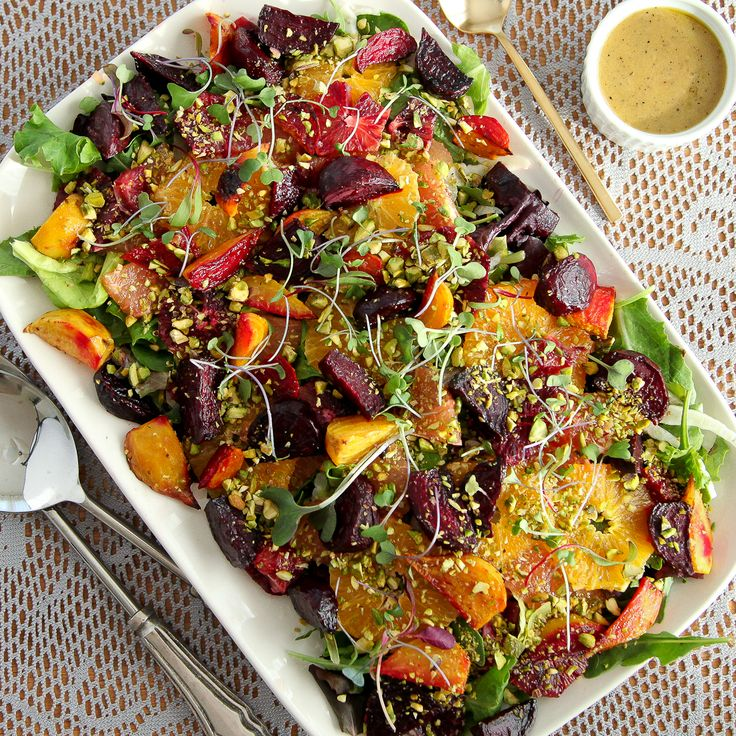 Roasted beet and citrus salad - with mustard vinaigrette roasted golden and red beets, blood orange and valencia oranges, ruby red grapefruit, shaved fennel, pistachio crumble, and a mustard vinaigrette all on top of loads of mixed greens. The perfect balance of savory and sweet – every bite more interesting than the next.