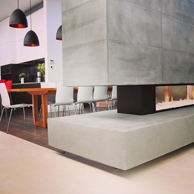 Here's some #interiorinspo for you. #escea #DX1500 double sided fireplace in a #Melbourne home. Who else loves their use of concrete for a sleek #industrial style? #interiordesign #interiors #firebyescea