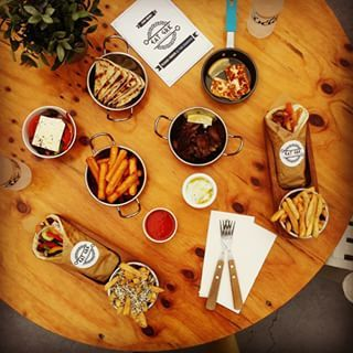 What a Greek table looks like at Eat GRK. #eatgrk #eat #greektable #food #foodgasm