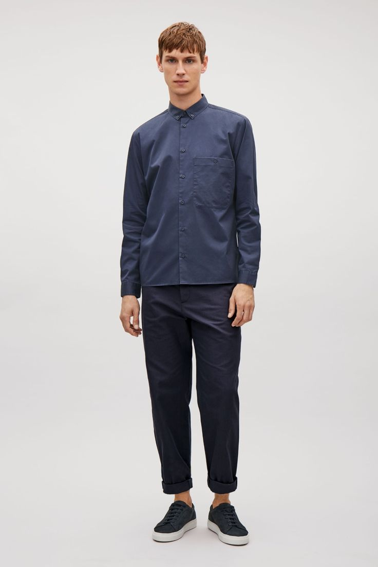 This casual shirt is cut from pure cotton with a soft washed, twill quality and a large, low-sitting, chest pocket. Designed for casual, everyday wear, it has a button-down narrow collar, long sleeves and a tonal button fastening along the front.