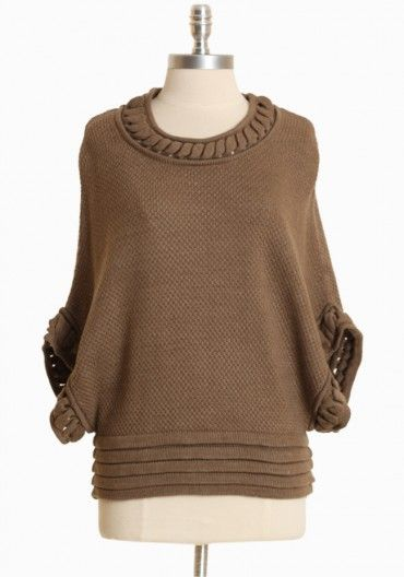 Oversized knit sweaters in classic colors like tan.