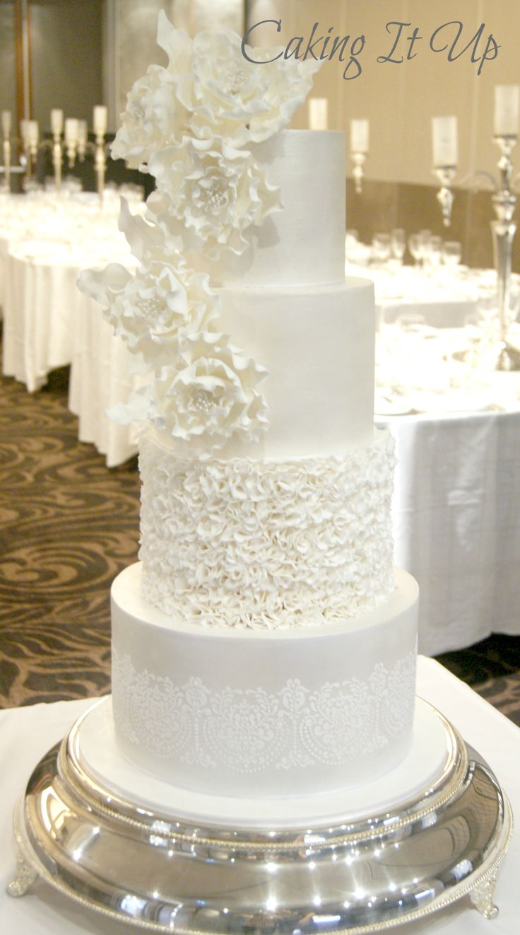 Gorgeous Four Tier All White Wedding Cake With Stencilling Ruffles And Pretty Sugar Flowers