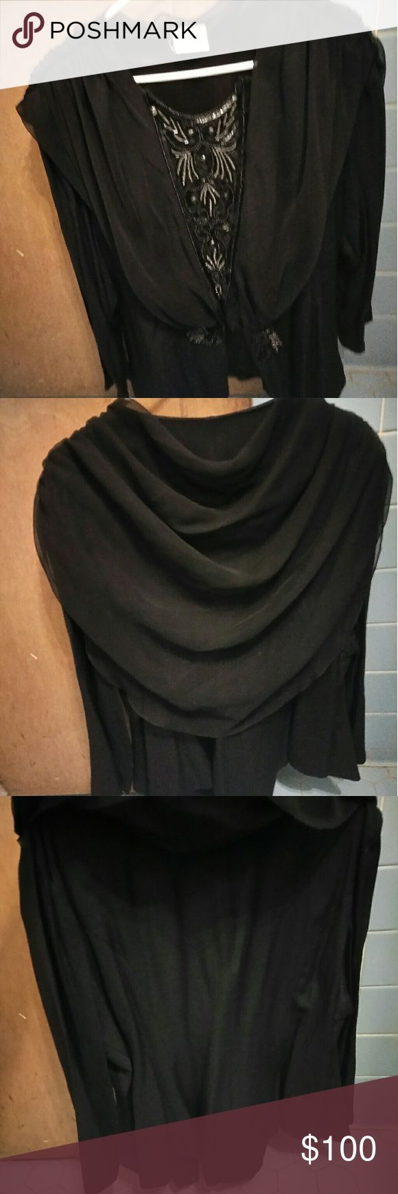 A beautiful ladies evening top Black dressy top or evening jacket. This top or jacket is simply beautiful. Never wore it. Just sitting in my closet. I'm not sure of the size or material. It looks like a large or XL. The beading is beautiful Tops Blouses