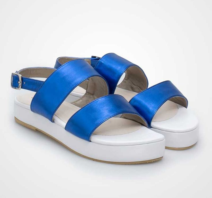 A white platform with double strap of metalic blue. By Sepatuku Baru. http://www.zocko.com/z/JIUnU