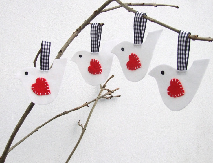 made from white felt with a contrasting red felt heart wing that has been hand sewn. A gingham ribbon is attached for hanging. They have little black sequin eyes. The decoration is one one side only.    Size – each bird is 10cm (4 inches) wide at the top with a 6cm (2 inch) ribbon. The total length is 12 cm (4 ½ inches)