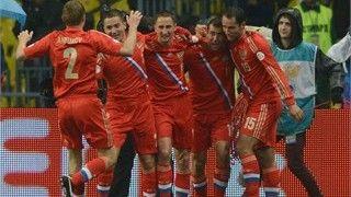 Russia's national football team players, (L-R) Aleksandr Anyukov, Viktor Fayzulin, Vladimir Bystrov, Aleksandr Kerzhakov and Roman Shirokov, celebrate