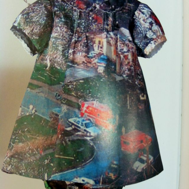 Shelly Goldsmith .... Baptism 2003. A reclaimed christening gown that is heat transfer printed of a photograph of the flood damage in Britain
