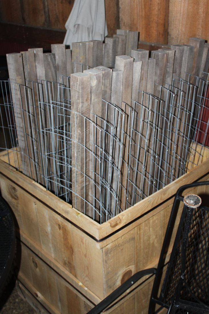 Our Stake-A-Cages stored during the winter in the barn.  Their design allows them to store easily