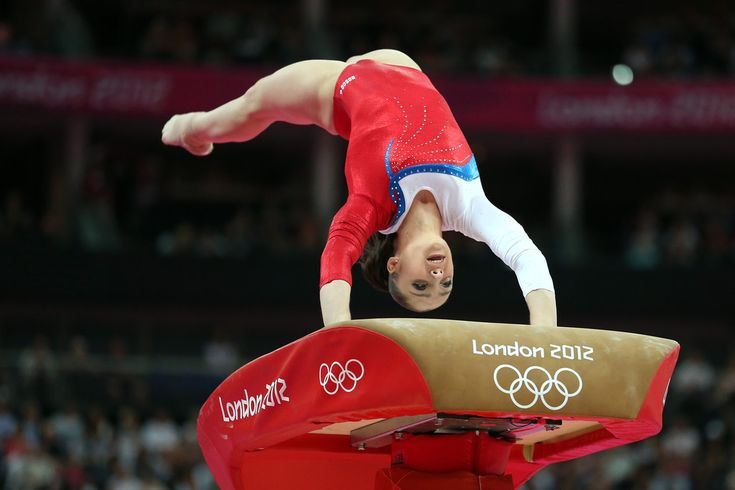 Aliya Mustafina of Russia competes on the vault in the Artistic Gymnastics Women's Team qualification on Day 2 of the London 2012 Olympic Games at North Greenwich Arena on July 29, 2012 in London, England.