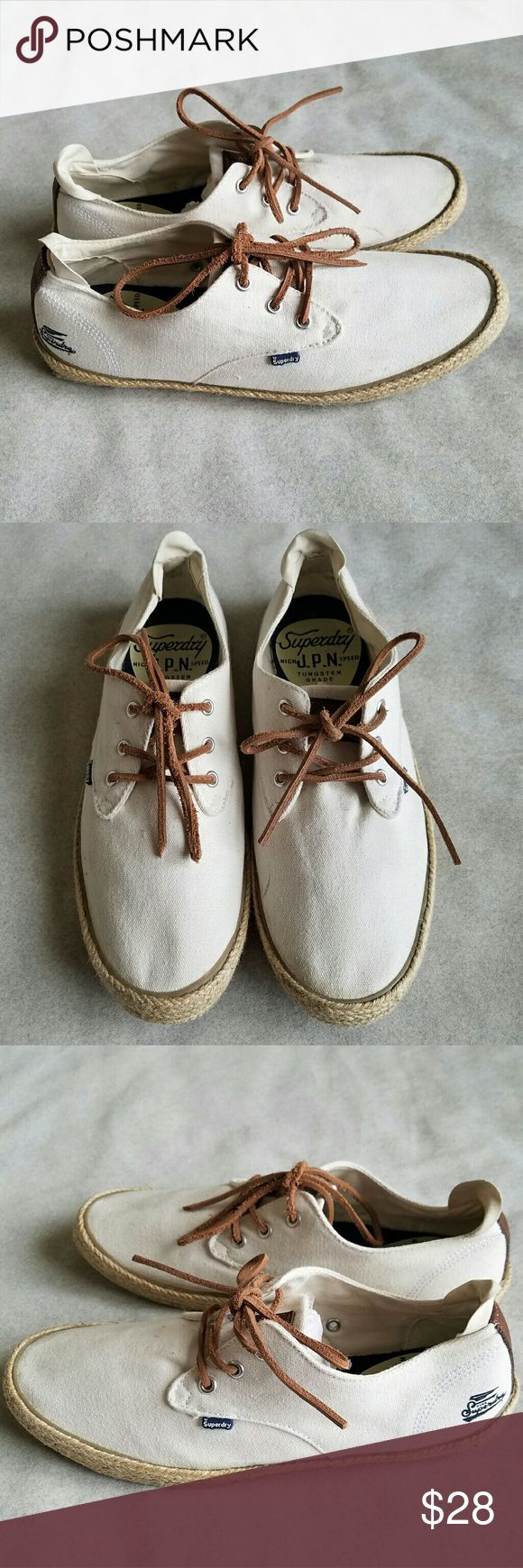 Men's Superdry Skipper Canvas Shoes Men's Superdry shoes with woven canvas upper. Leather cord laces with metal eyelets.  Espadrille sole with rubber tread.   Color is off white. Men's US size 10.   Excellent pre-owned owned condition. Minimal wear on soles. Superdry Shoes