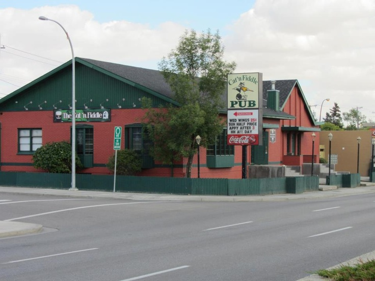Cat and Fiddle Pub in Calgary, Alberta  - this Scottish pub used to be a funeral home and is haunted by a former mortician  - he does materialize but is more often heard in the form of footsteps, makes light anomalies appear, and gives off a feeling of being watched