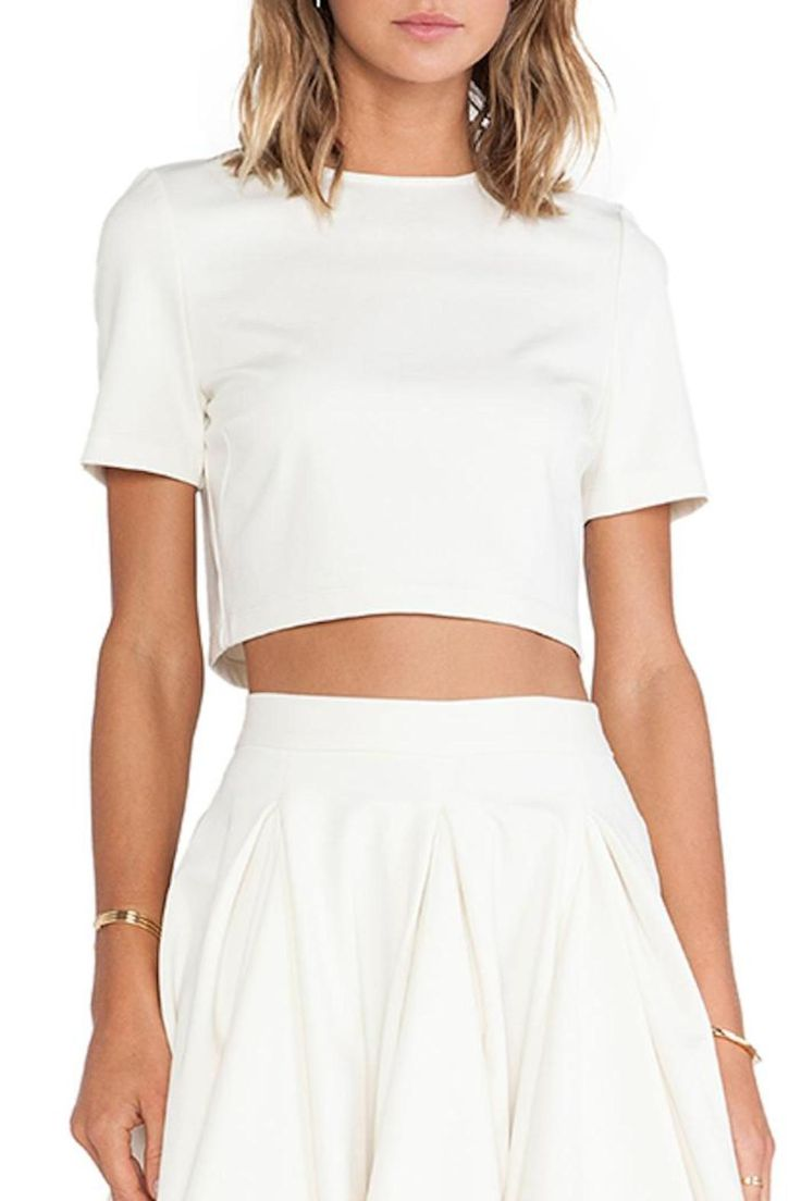 Crop top with hidden back zipper. Pairs nicely with high waisted skirts and denim.   Dugan Top by Torn by Ronny Kobo. Clothing - Tops - Tees & Tanks Clothing - Tops - Crop Tops Clothing - Tops - Short Sleeve Pennsylvania
