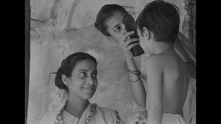 Pather Panchali: Loving mother and daughter taking care of the youngest son. The capture speaks for itself actually.