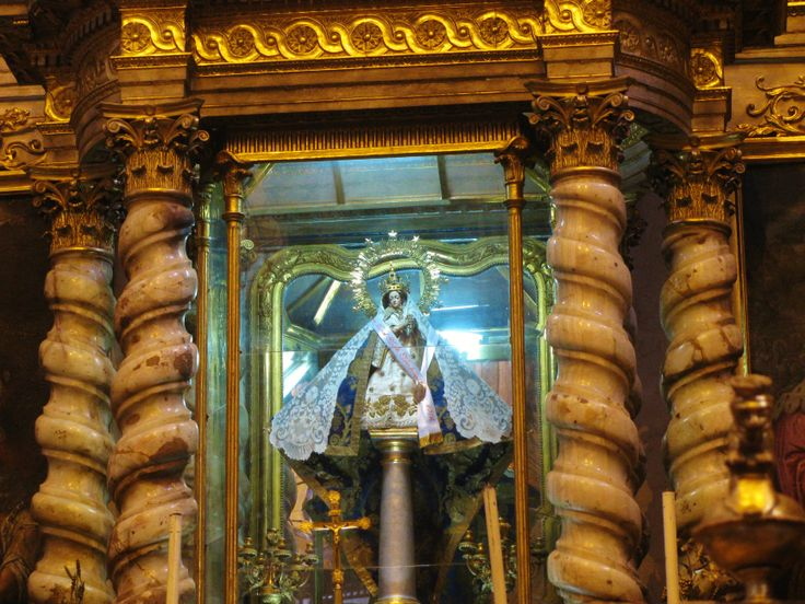 The miraculous statue of Our Lady of the Pillar above the main altar in Puebla's Cathedral. MADONNAS OF MEXICO