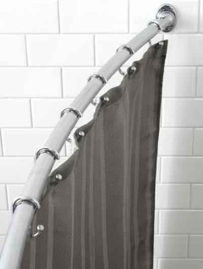 31 Cheap Tricks For Making Your Bathroom The Best Room In The House -  Use a curved shower rod for a bigger feeling shower