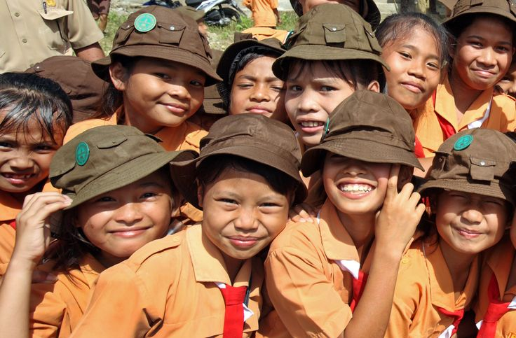 Girls in scout uniform (every friday) posing for a photo. North Nias Regency, Nias Island, Indonesia. Photo by Bjorn Svensson. www.northniastourism.com
