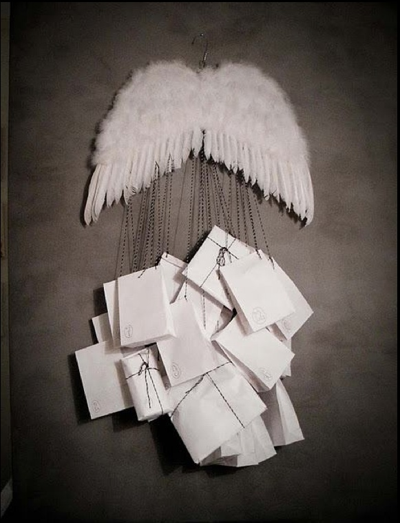Advent calendar with angel wings, but use stars as the trail....