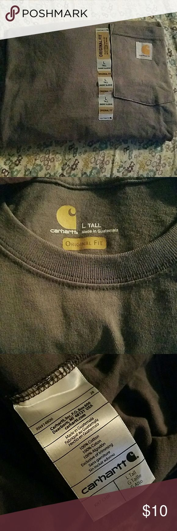 NWT Carhartt Work Shirt Too small on the boyfriend, too big for me.  Brand new, never worn Carhartt tall, short sleeve work shirt. If you know anything about the brand you know this work shirt will last you for years no matter what you throw at it. Since it's sized tall it's perfect for tucking in and staying there.  Medium gray color Carhartt Shirts Tees - Short Sleeve