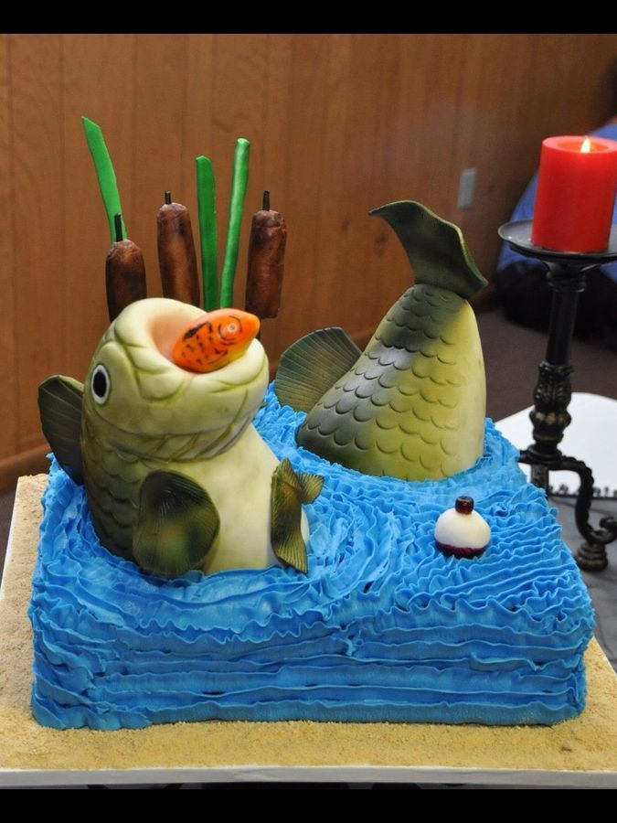 Chocolate cake and the bodies of the fish were made with rkt covered in fondant then air brushed. The fins, grass and cat tails were made with gum paste. There is a great tutorial on this cake somewhere on the net, but I'm not sure if the person is on this site so I can't give them credit yet.