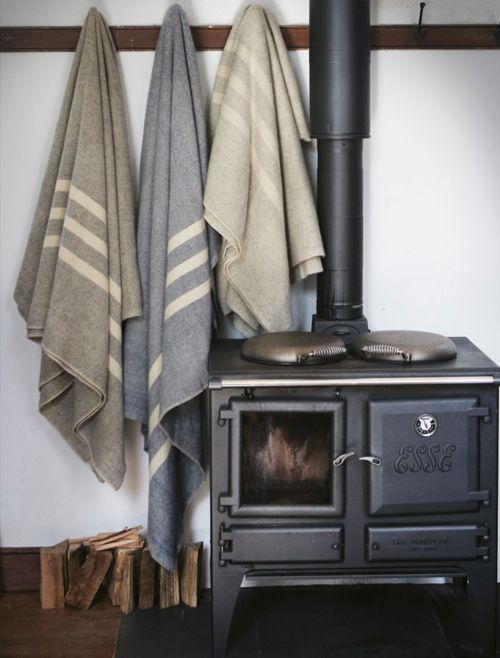 Hooks by wood burning stove a good idea for coats, towels, etc. (Stockings at Christmas)