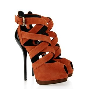 Giuseppe Zanotti | A silhouette that doesn't hide feet, but dresses and enhances them: this is the mood conjured by these strappy booties in saffron-colored suede with a black lacquered heel inspired by the female form.